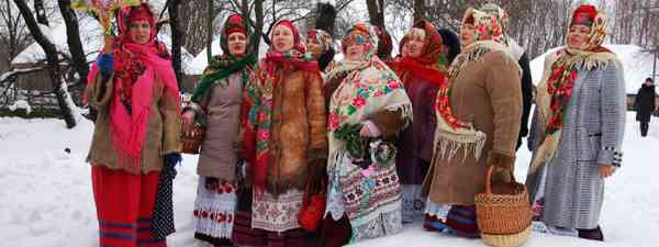 Folk Ukrainian Group celebrating Christmas Day in open air Museum of Folk Architecture and Rural Life, Kiev (Shutterstock: see credit below)