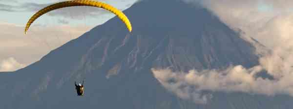 Paragliding over Tungurahua volcano in Ecuador (Shutterstock: see credit below)