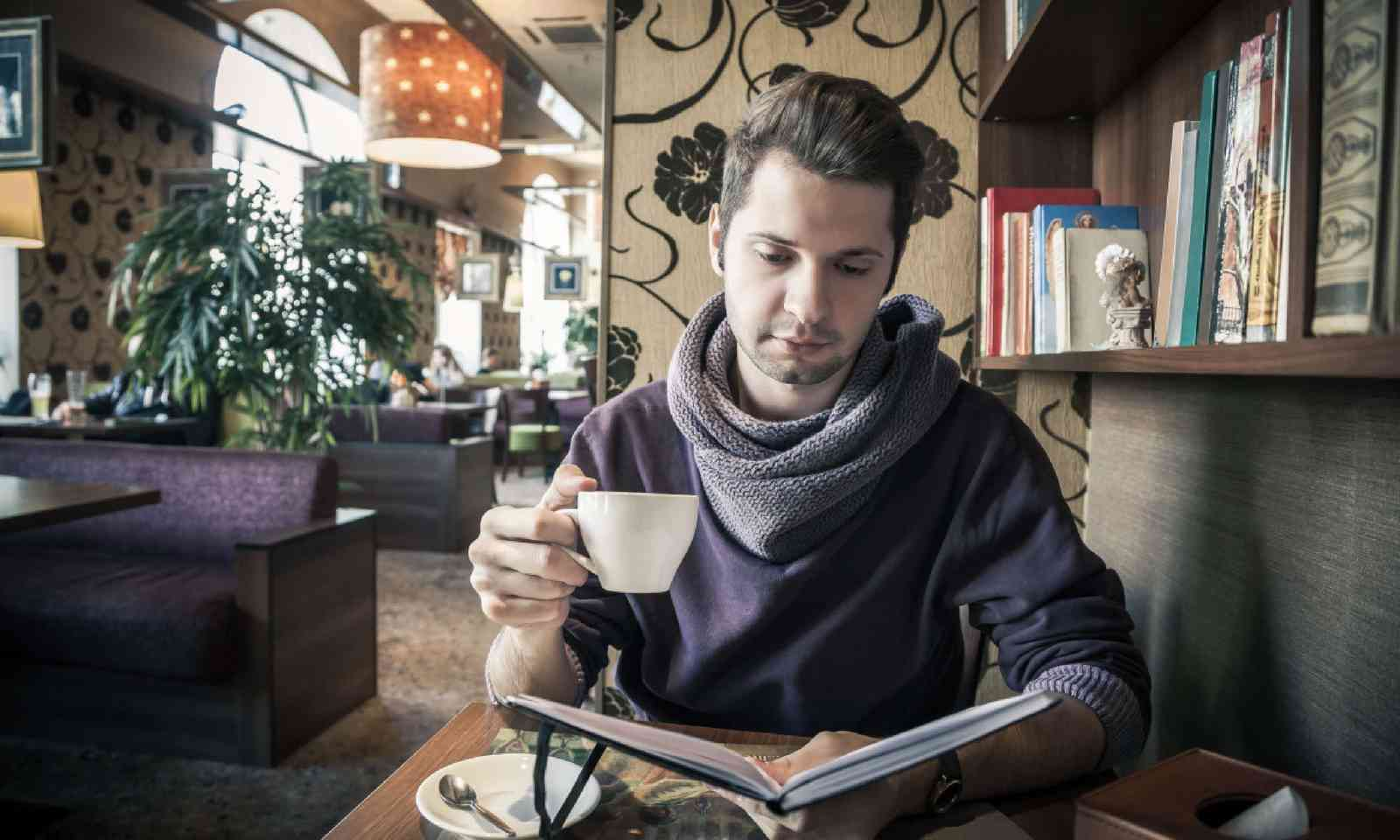 Reading in a cafe (Shutterstock)