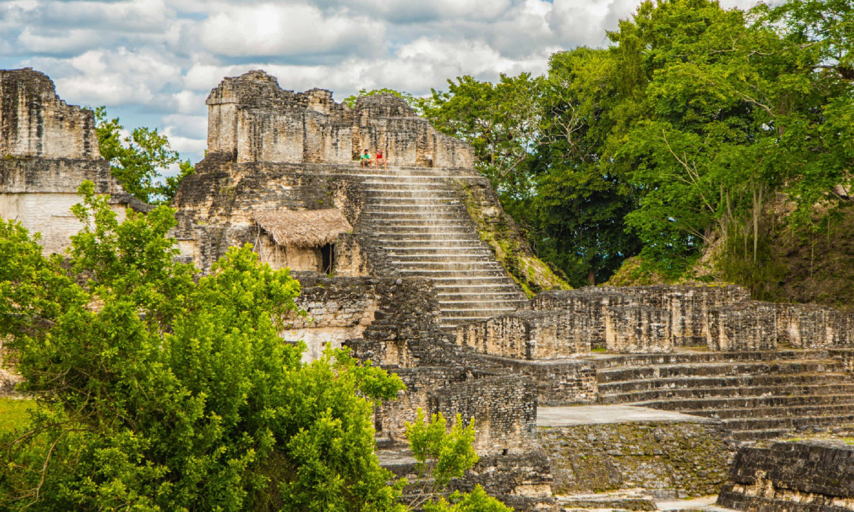 Ancient Mayan pyramid and ruins in Tikal (Shutterstock)