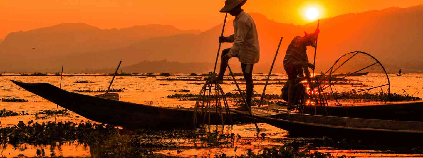 Fishermen in Inle lakes sunset (Shutterstock: see credit below)
