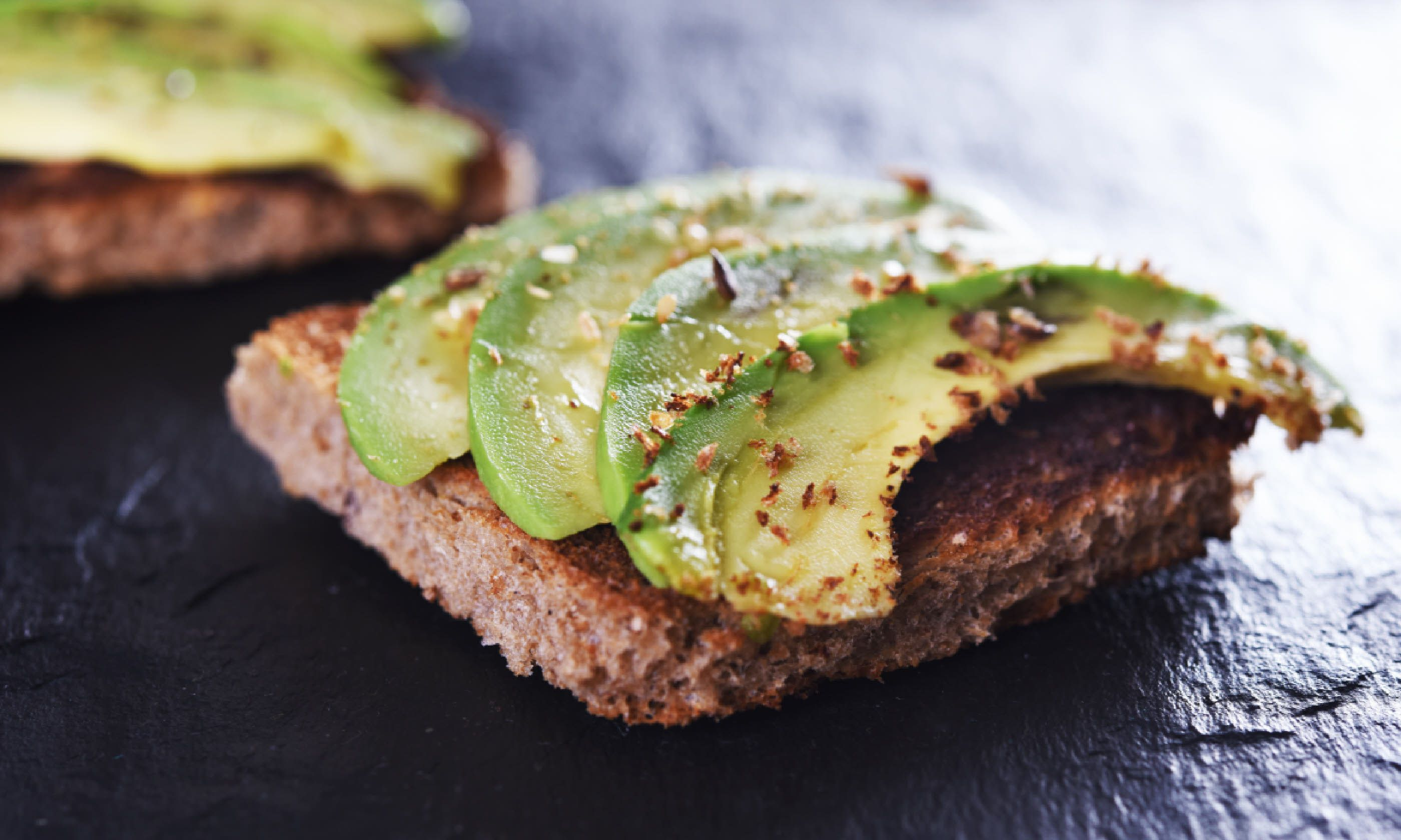 Sliced avocado on toast (Shutterstock)