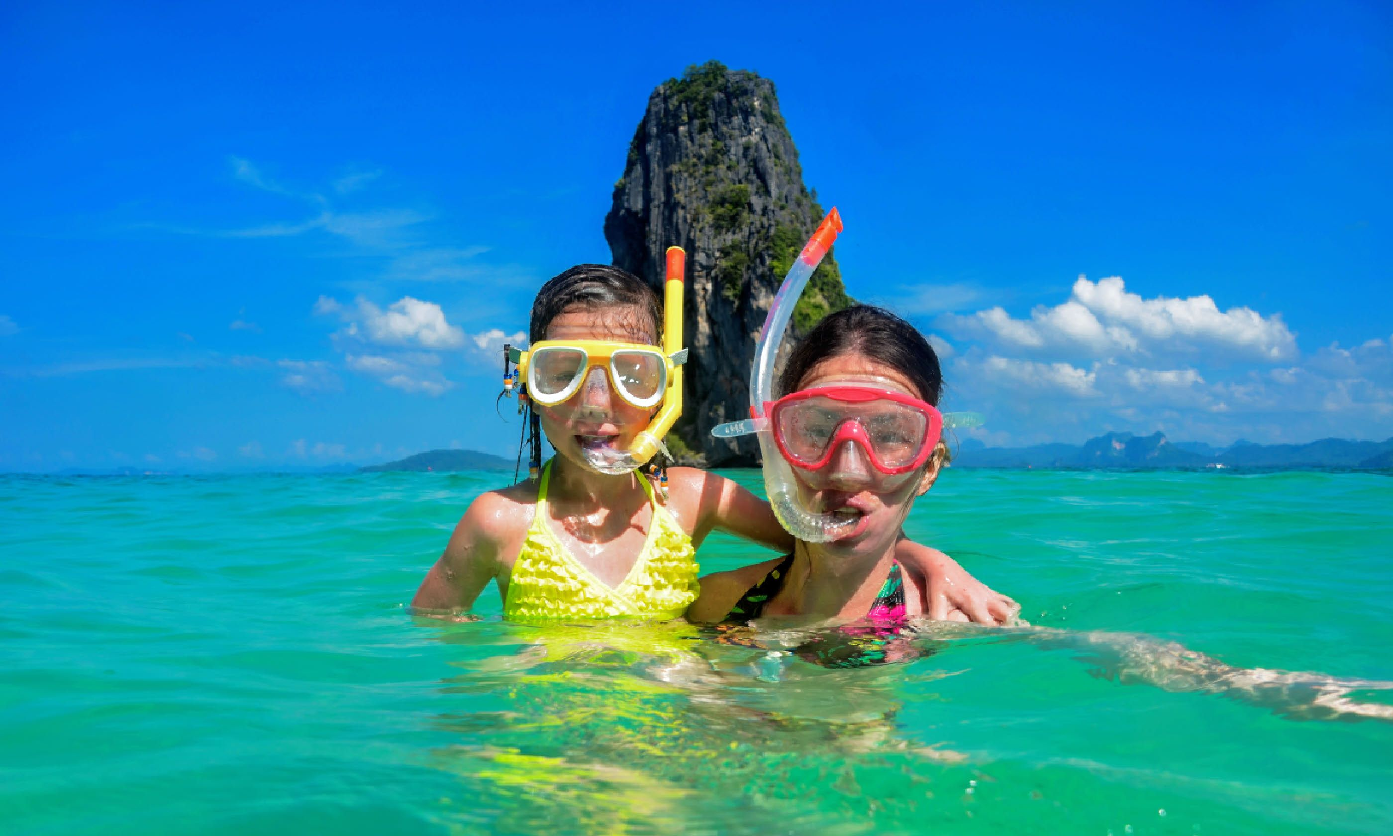 Mother and kid snorkelling in sea in Thailand (Shutterstock)