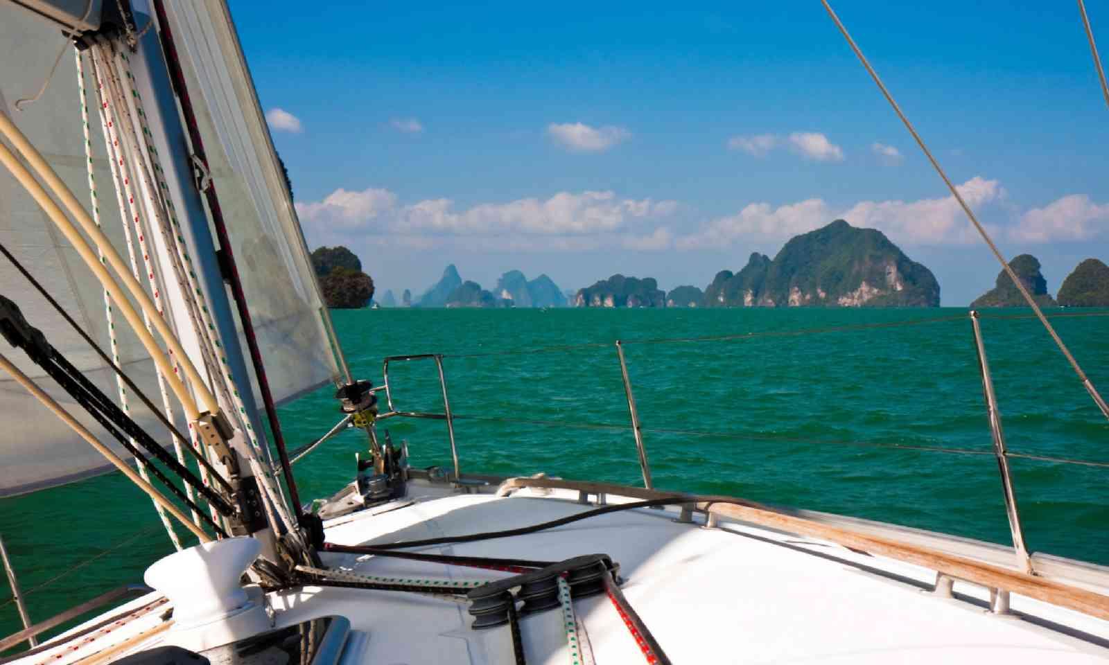 Sailboat heading towards Phang-Nga Bay in Thailand (Shutterstock)