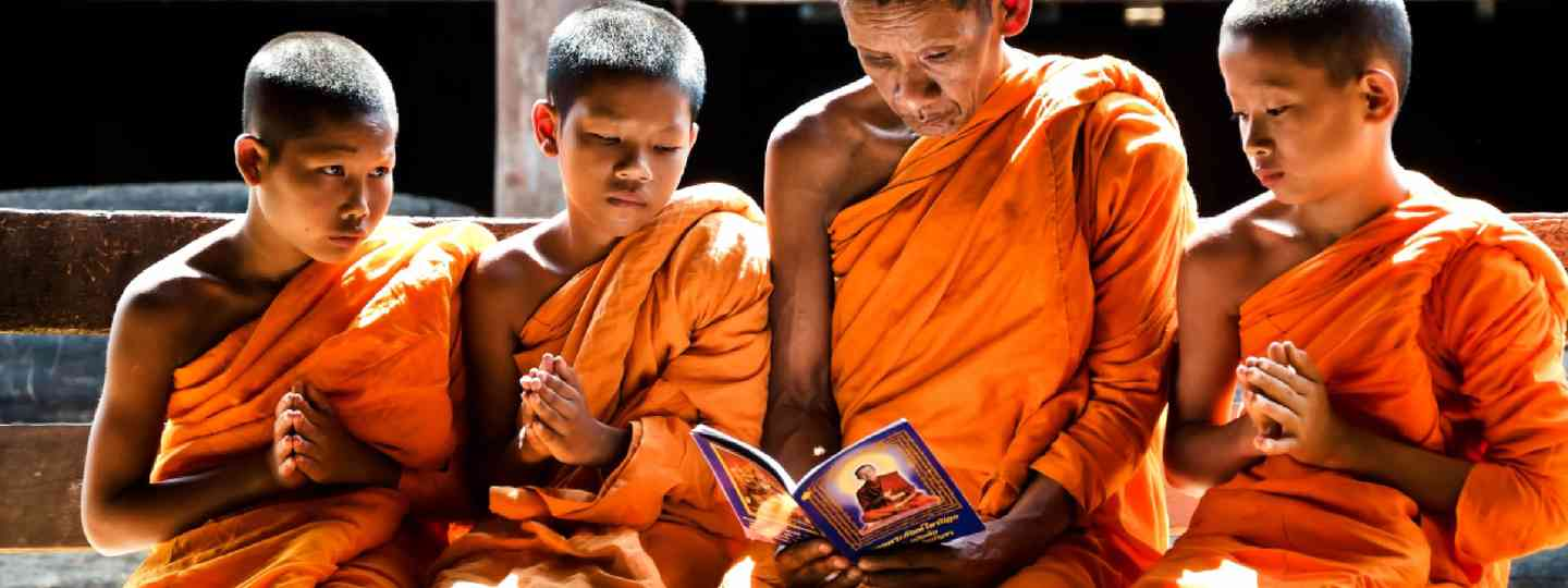 A monk teaches novice monks, Thailand (Shutterstock: see credit below)