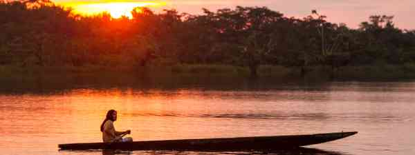 Canoeing on Laguna Grande, Cuyabeno NP, Ecuador (Shutterstock: see credit below)