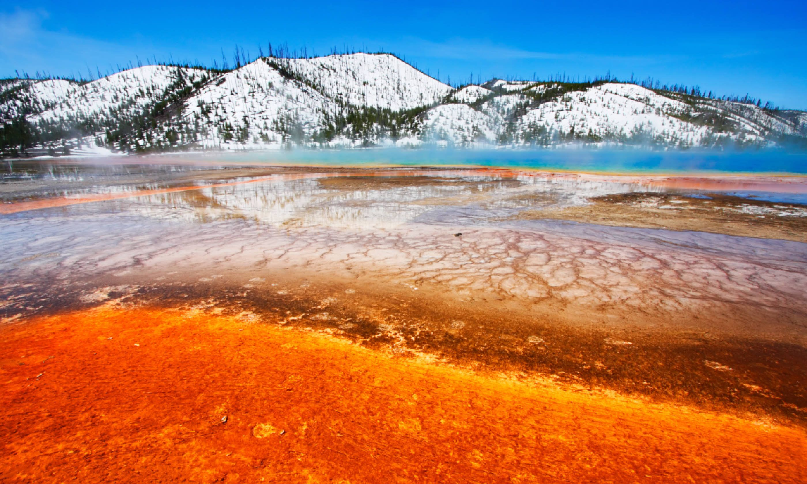 Grand Prismatic Spring with snow-covered hills, Yellowstone (Shutterstock)