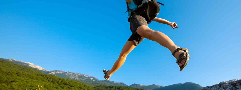 Hiker jumping (Shutterstock)