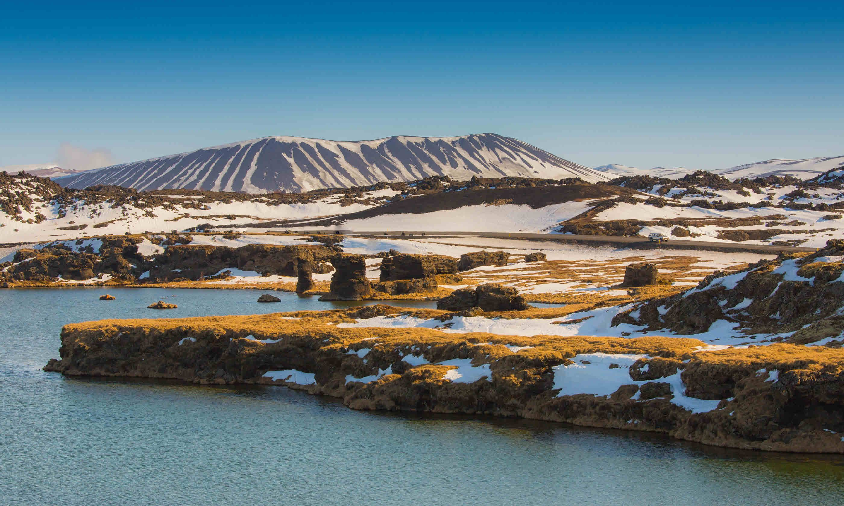 Valcano mount and lake in Myvatn (Shutterstock)